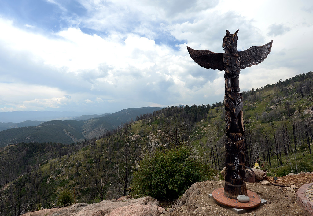 """. David Cottrell and his wife Kristen Moeller have rebuilt their home following the Lower North Fork Fire in 2012. They went from 1200 square feet to 500 square feet. They were at their home which is up Deer Creek Canyon  on Tuesday, July 15, 2014. It still has magnificent views. The couple will be featured in an upcoming episode of Tiny House Nation on FYI network. Moeller is author of the new book, \""""What Are You Waiting For? Learn How to Rise to the Occasion Of Your Life.\""""  (Denver Post Photo by Cyrus McCrimmon)"""