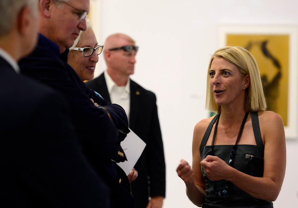 . Heidi Zuckerman Jacobson, right, director of the museum, gives visitors a tour of Galleries 2 and 3 where the work of David Hammons Yves Klein/ Yves Klein David Hammons is on display. Aspen Art Museum celebrates its grand opening to the public on Saturday, Aug. 2, 2014. The architect on the project, Shigeru Ban, was there for the celebration which included an official ribbon cutting and fireworks. (Photo by Kathryn Scott Osler/The Denver Post)