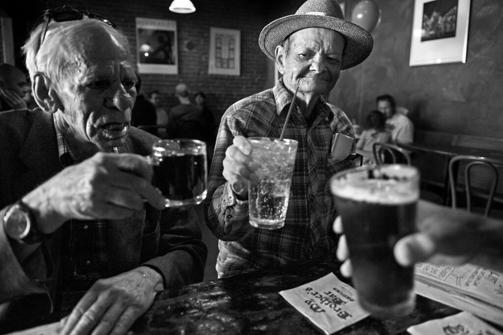 """. Cecil and Carl toast with a friend to celebrate Carl\'s 72nd birthday at My Brother\'s Bar in Denver. The couple agrees they met in a bar in 1969, but differ on the location. \""""There was a dispute we\'ve never settled about where we met. I say it was in Mary\'s Bar and Carl says it was the Backdoor,\"""" Cecil said. \""""He came up and asked me a silly question. We got to talking and we spent the night together. We decided to see each other again.\"""" (Photo By Craig F. Walker/The Denver Post)"""
