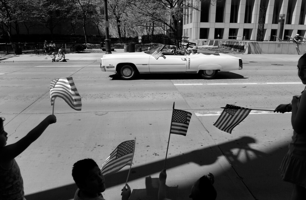 """. Cecil rides with Carl in a 1972 Cadillac Eldorado during the Memorial Day parade in Denver. The couple was invited to join the American Veterans for Equal Rights Colorado GLBT Color Guard, a group made of both gay veterans and gay service men and women who are active duty. Both Cecil and Carl served in the United States Air Force at a time when being gay was reason for dismissal. Cecil was a First Lieutenant in the Air Police, and Carl was an Airman First Class and a nuclear weapons instructor. \""""You just didn\'t do [or say] anything,\"""" Cecil said. \""""What\'s worse than being kicked out of the military would be going home and telling your family why...  we just didn\'t talk about it.\""""  (Photo By Craig F. Walker/The Denver Post)"""
