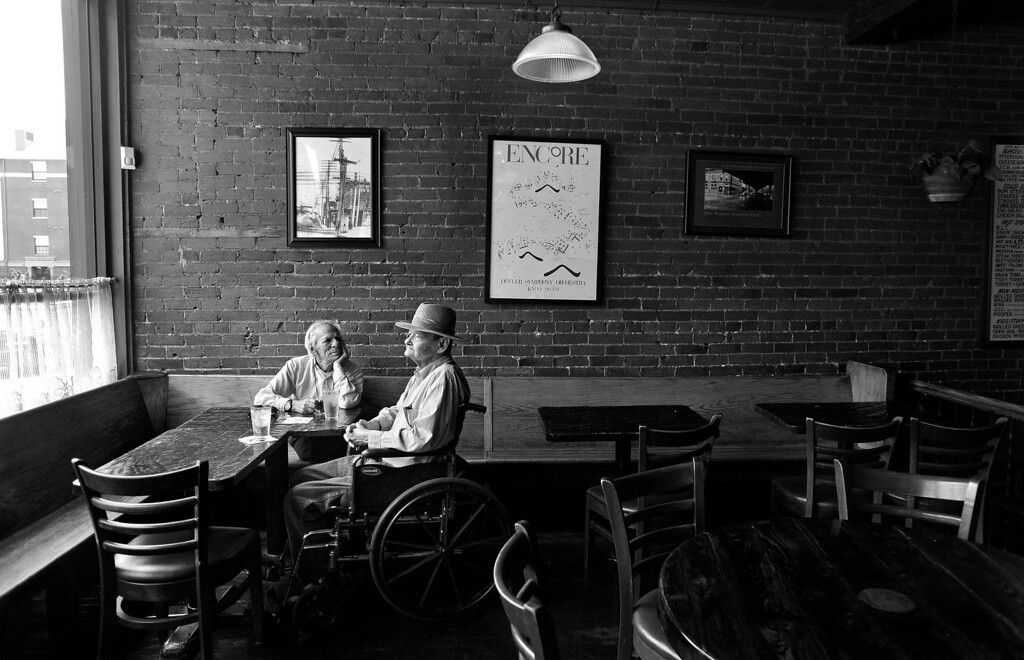 . Cecil sits quietly with Carl as they wait for their lunch at My Brother\'s Bar. Though marriage was never an option for the couple, Cecil said he believes others should have the right. He compared being gay and gay marriage to being black during the Civil Rights movement. �It�s sort of like the blacks in the south in the 60�s and the sit-ins at the Five & Dime,� Cecil said. �I don�t think they wanted to eat there � they wanted the right to eat there, and I think that�s the way so many gays feel. They aren�t particularly interested in marriage, but they want the right to be married.� (Photo by Craig F. Walker/ The Denver Post)