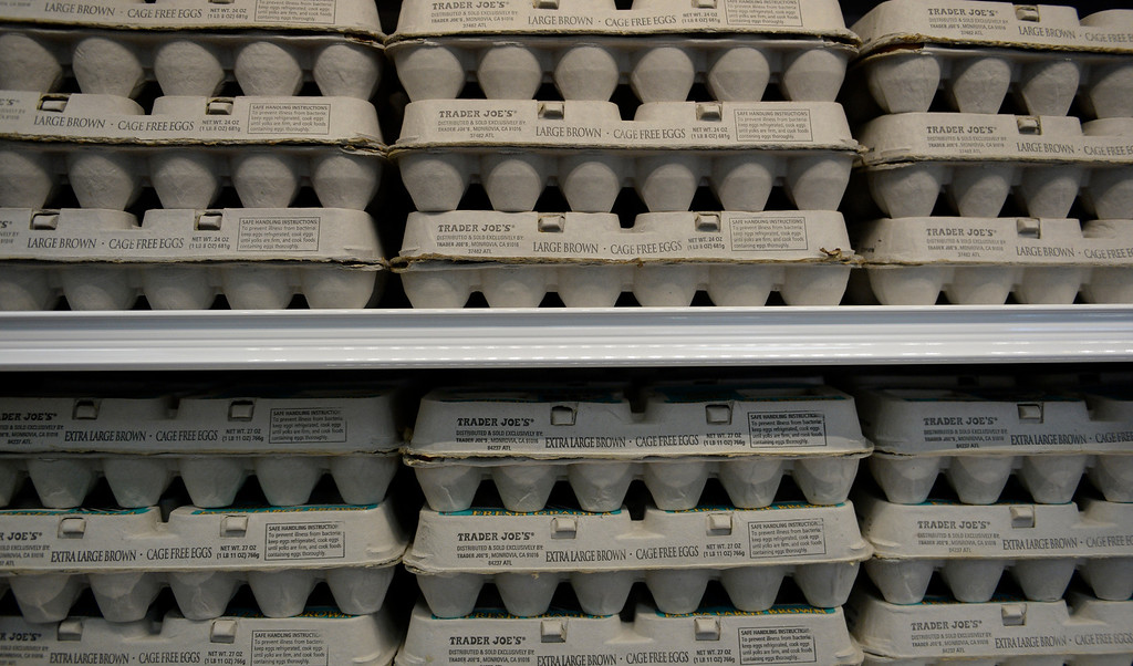 . Eggs line the shelves at the new Trader Joe\'s, located on Colorado Blvd. and East 8th Avenue in Denver, for the grand opening of specialty grocer, February, 14 2014. Two other Trader Joe\'s locations in Colorado will also open today. (Photo by RJ Sangosti/The Denver Post)