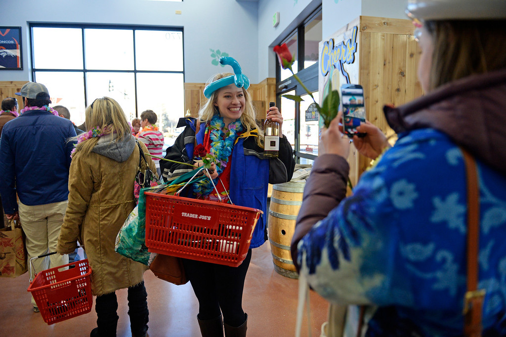. Mary Kate Douglas, left, has her friend, Paige Mullen, take a photo of her in line to checkout during the grand opening of specialty grocer Trader Joe\'s located on Colorado Blvd. and East 8th Avenue in Denver, February, 14 2014. Two other Trader Joe\'s locations in Colorado will also open today. (Photo by RJ Sangosti/The Denver Post)