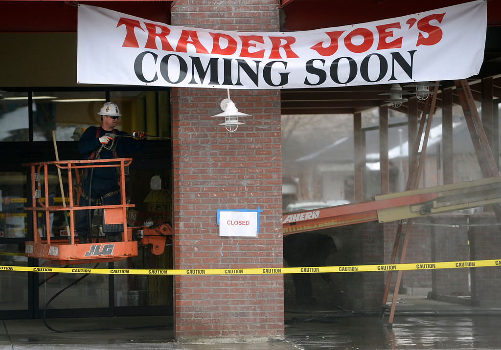 . DENVER, CO - FEBRUARY 11: Construction crews power-wash the outside of the south entrance to the store. Trader Joe\'s will open its first three stores Colorado on Friday and construction crews outside as well as employees inside, prepare the Colorado Blvd. and 8th Ave. store in Denver on Tuesday, Feb. 11, 2014. (Photo by Kathryn Scott Osler/The Denver Post)