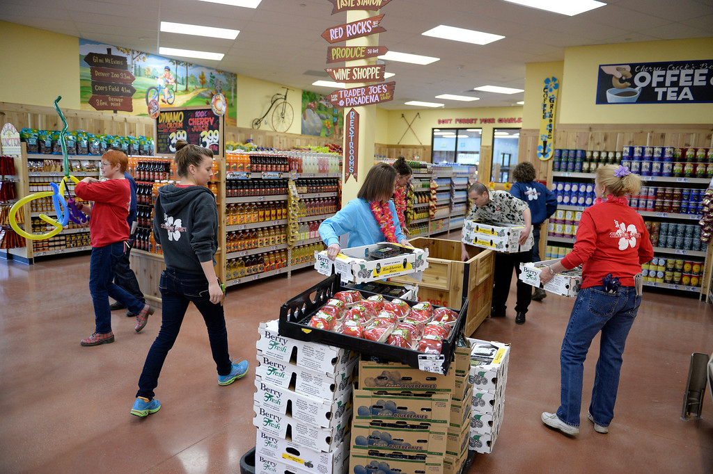 . Employees at the new Trader Joe\'s, located on Colorado Blvd. and East 8th Avenue in Denver, get ready for the grand opening of specialty grocer, February, 14 2014. Two other Trader Joe\'s locations in Colorado will also open today. (Photo by RJ Sangosti/The Denver Post)