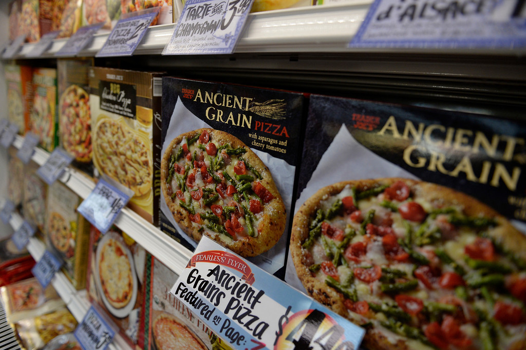 . Frozen pizzas line the shelves at the new Trader Joe\'s, located on Colorado Blvd. and East 8th Avenue in Denver, for the grand opening of specialty grocer, February, 14 2014. Two other Trader Joe\'s locations in Colorado will also open today. (Photo by RJ Sangosti/The Denver Post)