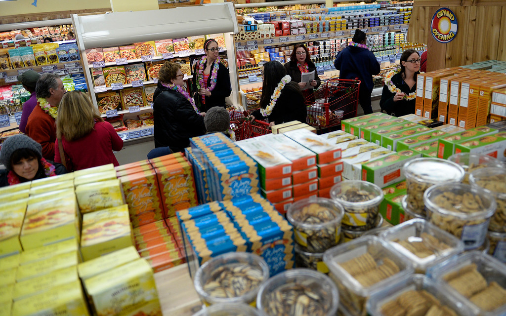 . People crowd into the new Trader Joe\'s, located on Colorado Blvd. and East 8th Avenue in Denver, for the grand opening of specialty grocer, February, 14 2014. Two other Trader Joe\'s locations in Colorado will also open today. (Photo by RJ Sangosti/The Denver Post)