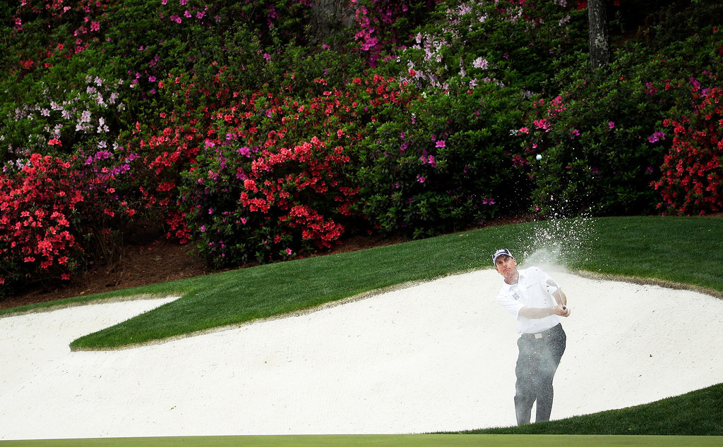 . Jim Furyk hits out of a bunker on the 13th hole during the fourth round of the Masters golf tournament Sunday, April 13, 2014, in Augusta, Ga. (AP Photo/Chris Carlson)
