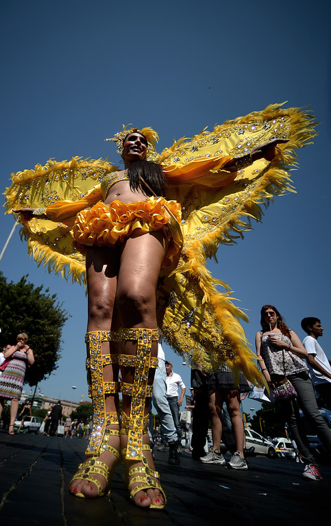. A demonstrator poses in a yellow outfit during the annual gay pride parade in downtown Rome on June 15, 2013. Tens of thousands of people paraded noisily on floats through the historic streets of Rome on June 15 to celebrate Gay Pride, amid calls for Italy to follow France\'s example in legalising gay marriage.  AFP PHOTO/ FILIPPO  MONTEFORTE/AFP/Getty Images
