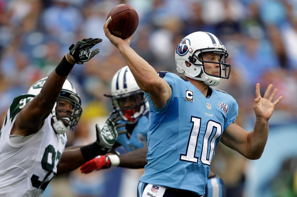 . Tennessee Titans quarterback Jake Locker (10) passes as he is pressured by New York Jets outside linebacker Calvin Pace (97) in the second quarter of an NFL football game on Sunday, Sept. 29, 2013, in Nashville, Tenn. (AP Photo/Wade Payne)
