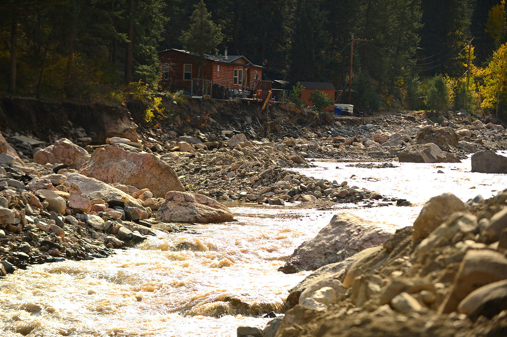 . Some homes are completely inaccessible along Highway 34 near Drake, Co on October 16, 2013.  For nearly three weeks now, the Colorado Department of Transportation and it\'s contractor Kiewit Infrastructure Co has been working on US 34 from both the Estes Park and Loveland sides to provide a temporary roadway by December 1, 2013. (Photo By Helen H. Richardson/ The Denver Post)