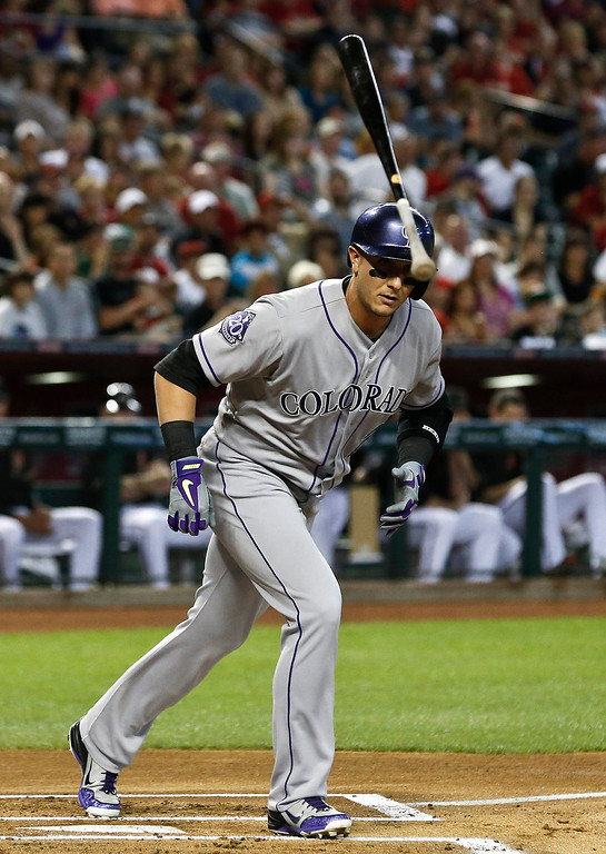 . Colorado Rockies\' Troy Tulowitzki flips his bat away after earning a walk against the Arizona Diamondbacks in the first inning during a baseball game, on Saturday, April 27, 2013, in Phoenix. AP Photo/Ross D. Franklin)