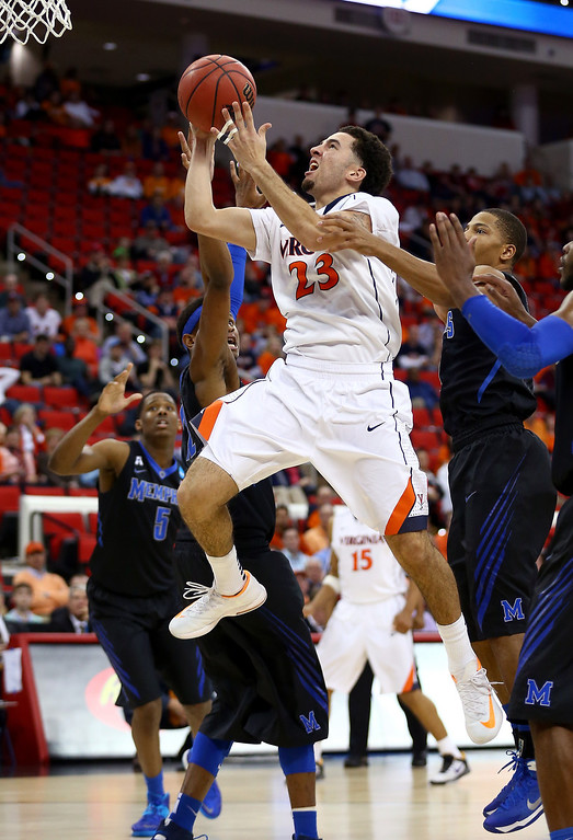 . London Perrantes #23 of the Virginia Cavaliers drives to the basket against Memphis Tigers in the second half during the third round of the 2014 NCAA Men\'s Basketball Tournament at PNC Arena on March 23, 2014 in Raleigh, North Carolina.  (Photo by Streeter Lecka/Getty Images)