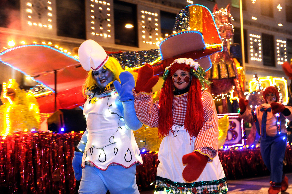 . DENVER, CO. - DECEMBER 06: Raggedy Ann and a Smurf waved to young fans who braved the cold as the 9News Parade of Lights kicked off Friday night, December 6, 2013. The weather was clear but temperatures dipped below zero. Photo By Karl Gehring/The Denver Post