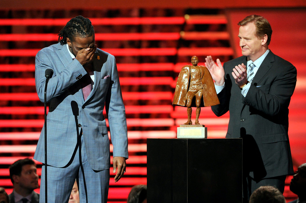 . Charles Tillman of the Chicago Bears, left, accepts the award for Walter Payton NFL Man of the Year from NFL Commissioner Roger Goodell at the third annual NFL Honors at Radio City Music Hall on Saturday, Feb. 1, 2014, in New York. (Photo by Evan Agostini/Invision for NFL/AP Images)