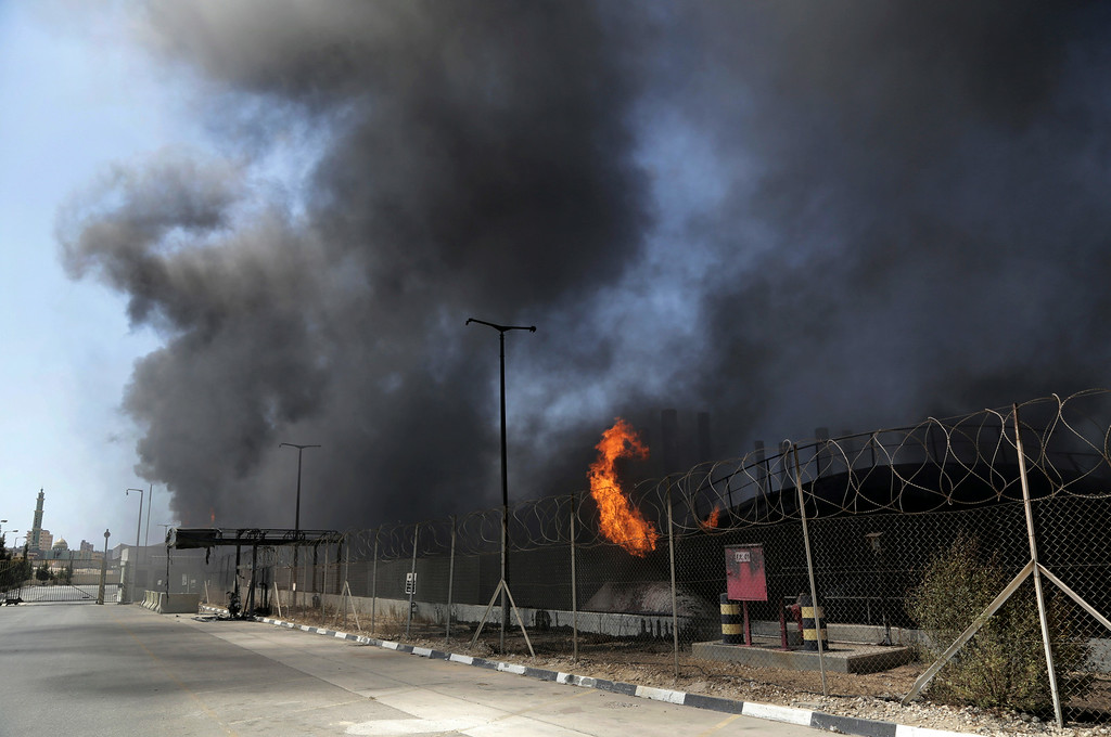 . Smoke and flames rise from the Gaza power plant after it was hit by Israeli strikes, in the Nusseirat refugee camp, central Gaza Strip,Tuesday, July 29, 2014. Israel escalated its military campaign against Hamas on Tuesday, striking symbols of the group\'s control in Gaza and firing tank shells that shut down the strip\'s only power plant in the heaviest bombardment in the fighting so far. The plantís shutdown was bound to lead to further serious disruptions of the flow of electricity and water to Gazaís 1.7 million people. (AP Photo/Adel Hana)