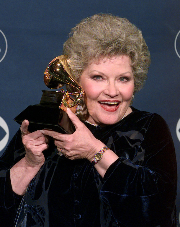 . Patti Page holds up her award for best traditional pop vocal performance during the 41st Annual Grammy Awards at the Shrine Auditorium in Los Angeles Wednesday, Feb. 24, 1999.  (AP Photo/Reed Saxon)