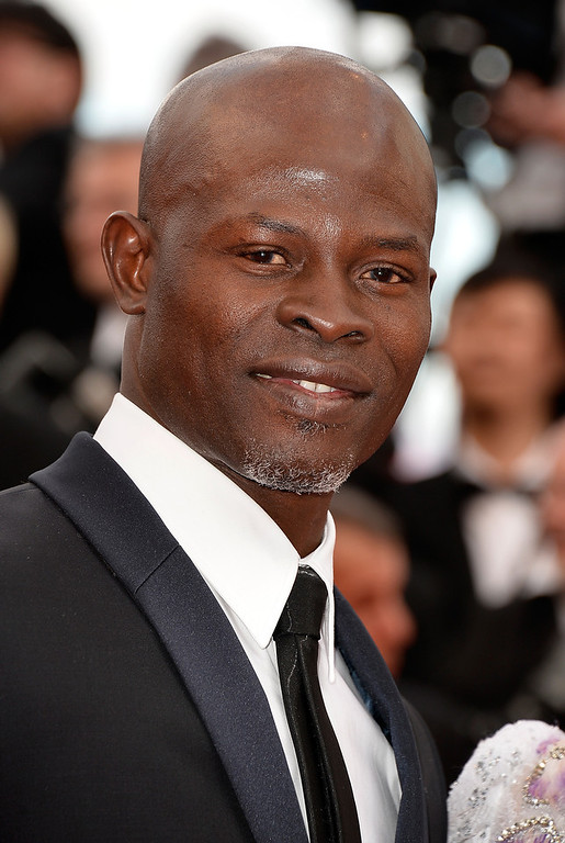 """. Djimon Hounsou attends the Opening ceremony and the \""""Grace of Monaco\"""" Premiere during the 67th Annual Cannes Film Festival on May 14, 2014 in Cannes, France.  (Photo by Pascal Le Segretain/Getty Images)"""