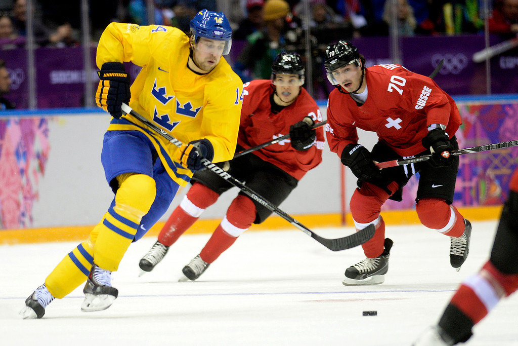 . Sweden\'s Patrik Berglund brings the puck up the ice against Switzerland during the action at Bolshoy Arena. Sochi 2014 Winter Olympics on Friday, February 14, 2014. (Photo by AAron Ontiveroz/The Denver Post)