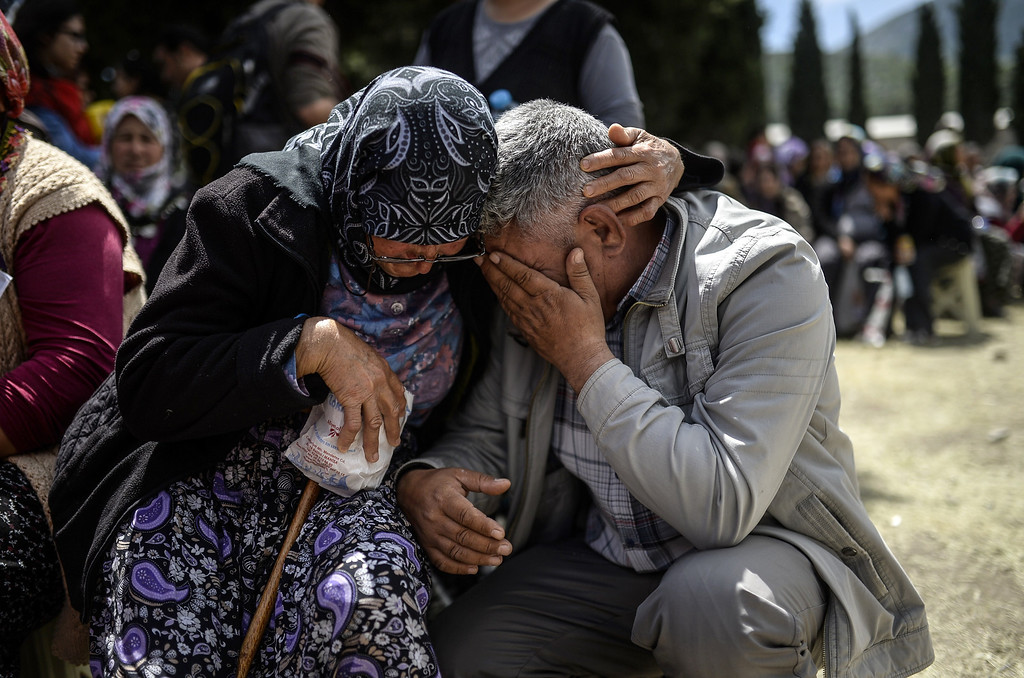 . People react during a funeral ceremony of miners who died in an explosion on May 15, 2014, in the western town of Soma in the Manisa province. Police intervened twice when around 20,000 protesters took to the streets in the western city of Izmir to protest the death of 282 miners in the country\'s worst ever industrial accident, Dogan news agency reported. AFP PHOTO/BULENT KILIC/AFP/Getty Images