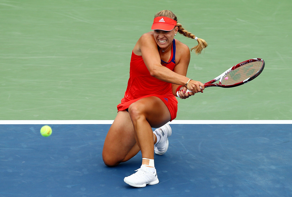 . NEW YORK, NY - AUGUST 29:  Angelique Kerber of Germany returns a shot to Eugenie Bouchard of Canada during their second round women\'s singles match on Day Four of the 2013 US Open at USTA Billie Jean King National Tennis Center on August 29, 2013 in the Flushing neighborhood of the Queens borough of New York City.  (Photo by Elsa/Getty Images)