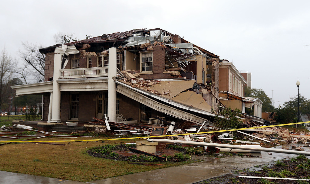 . Ogletree House lies in ruins on the campus of the University of Southern Mississippi in Hattiesburg, Miss., Monday, Feb. 11, 2013, after a tornado struck the area Sunday afternoon. The building, built in 1912, housed the university alumni association offices. (AP Photo/Chuck Cook)