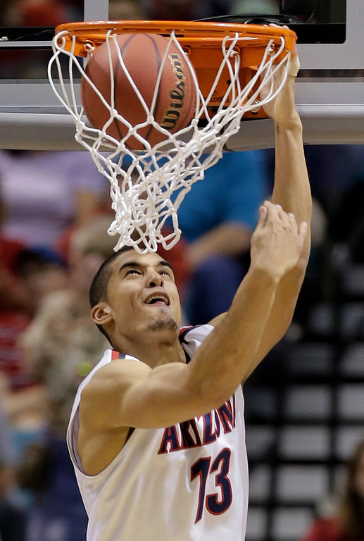 . Arizona\'s Nick Johnson dunks the ball against Colorado during the second half of an NCAA college basketball game in the semifinals of the Pac-12 Conference on Friday, March 14, 2014, in Las Vegas. Arizona won 63-43. (AP Photo/Julie Jacobson)