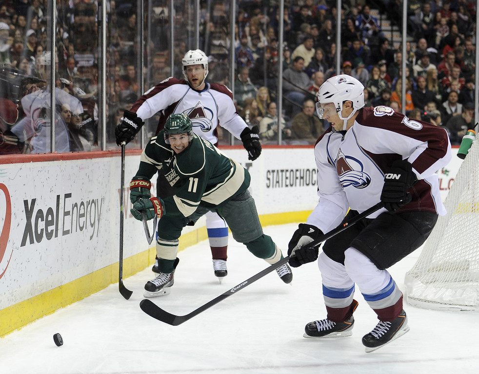 . Zach Parise #11 of the Minnesota Wild and Erik Johnson #6 of the Colorado Avalanche skate after the puck during the second period of the game on November 29, 2013 at Xcel Energy Center in St Paul, Minnesota. The Avalanche defeated the Wild 3-1. (Photo by Hannah Foslien/Getty Images)