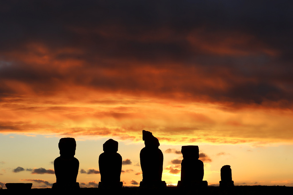 . The sun sets behind Moais  -- stone statues of the Rapa Nui culture -- on Easter Island, 3700 km off the Chilean coast in the Pacific Ocean, on July 12, 2010. MARTIN BERNETTI/AFP/Getty Images