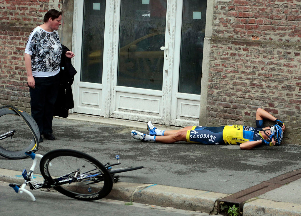 . Team Saxo Bank rider Jonathan Cantwell of Australia lies on the ground after a fall during the fifth stage of the 99th Tour de France cycling race between Rouen and Saint-Quentin, July 5, 2012. REUTERS/Joel Saget/Pool