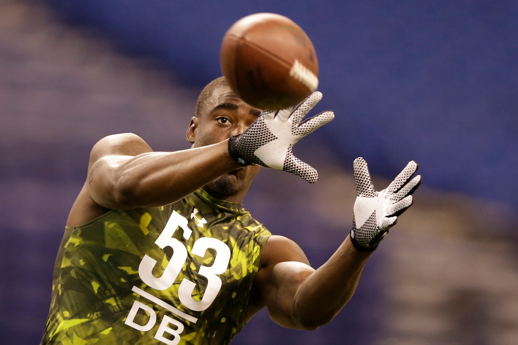 . South Florida defensive back Kayvon Webster runs a drill at the NFL football scouting combine in Indianapolis, Tuesday, Feb. 26, 2013. (AP Photo/Michael Conroy)