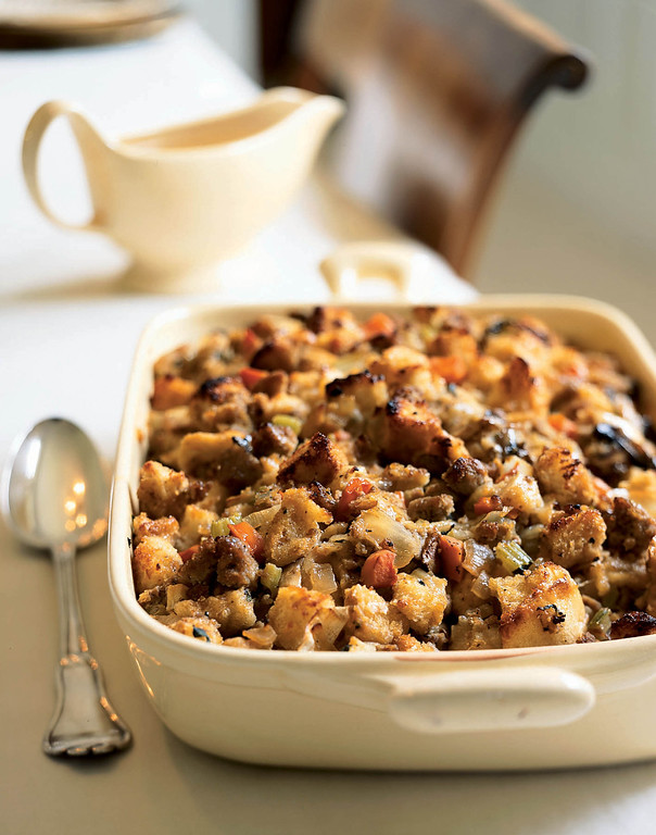 . This photo provided by Cooking Light magazine shows Sourdough Stuffing With Pears and Sausage, baked separately from the turkey that\'s the traditional centerpiece of your Thanksgiving dinner. This stuffing has a creative combination of familiar ingredients and will play a great supporting role to meal _ the sourdough bread gives it a tangy flavor. (AP Photo/Cooking Light/Becky Luigart-Stayner)