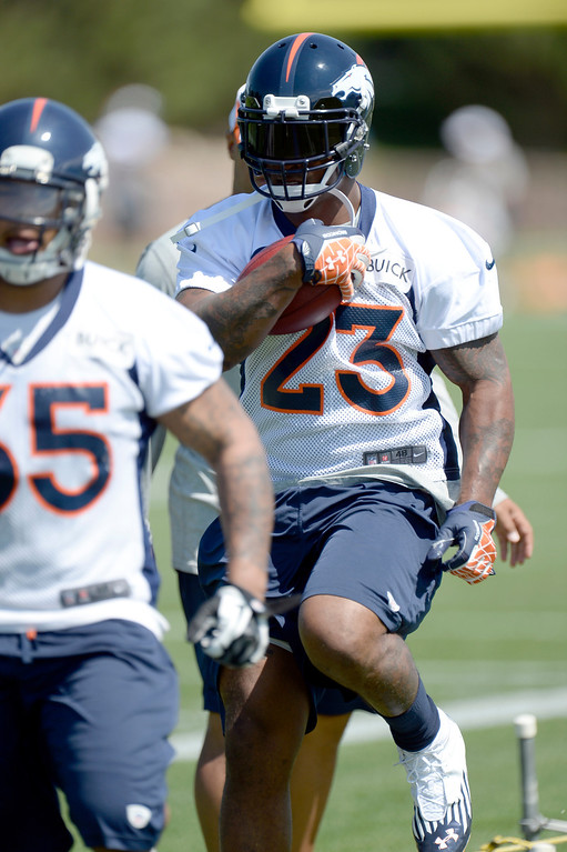 . Running back Willis McGahee (23) of the Denver Broncos works on drills during mini camp June 11, 2013 at Dove Valley. (Photo By John Leyba/The Denver Post)