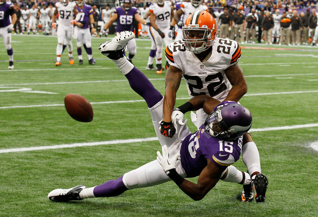 . Cleveland Browns cornerback Buster Skrine (22) breaks up a pass in the end zone intended for Minnesota Vikings wide receiver Greg Jennings (15) during the first half of an NFL football game Sunday, Sept. 22, 2013, in Minneapolis. (AP Photo/Ann Heisenfelt)