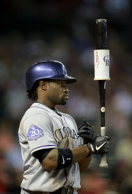 . Eric Young Jr. #1 of the Colorado Rockies warms up on deck during the MLB game against the Arizona Diamondbacks at Chase Field on April 28, 2013 in Phoenix, Arizona.  (Photo by Christian Petersen/Getty Images)