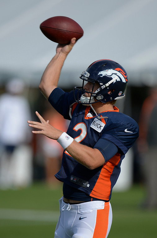. Denver Broncos QB Zac Dysert (2) warms up  during training camp August 1, 2013 at Dove Valley. (Photo By John Leyba/The Denver Post)