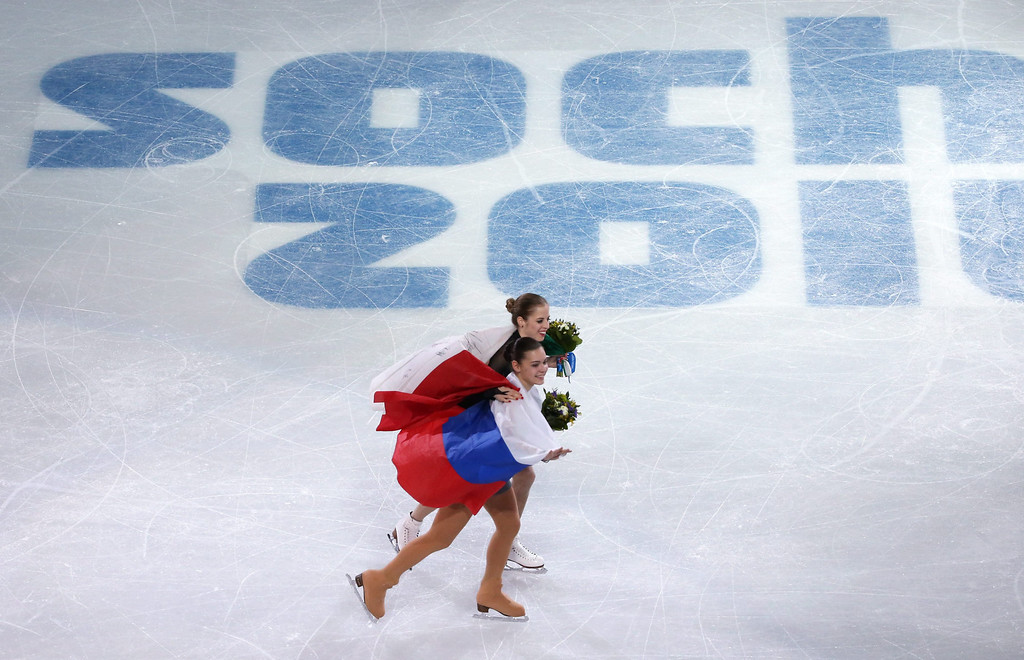 . Gold medalist Adelina Sotnikova (front) of Russia and bronze medalist Carolina Kostner of Italy celebrate after the flower ceremony after the Figure Skating Women\'s Free Skating event at Iceberg Skating Palace during the Sochi 2014 Olympic Games, Sochi, Russia, 20 February 2014.  EPA/BARBARA WALTON