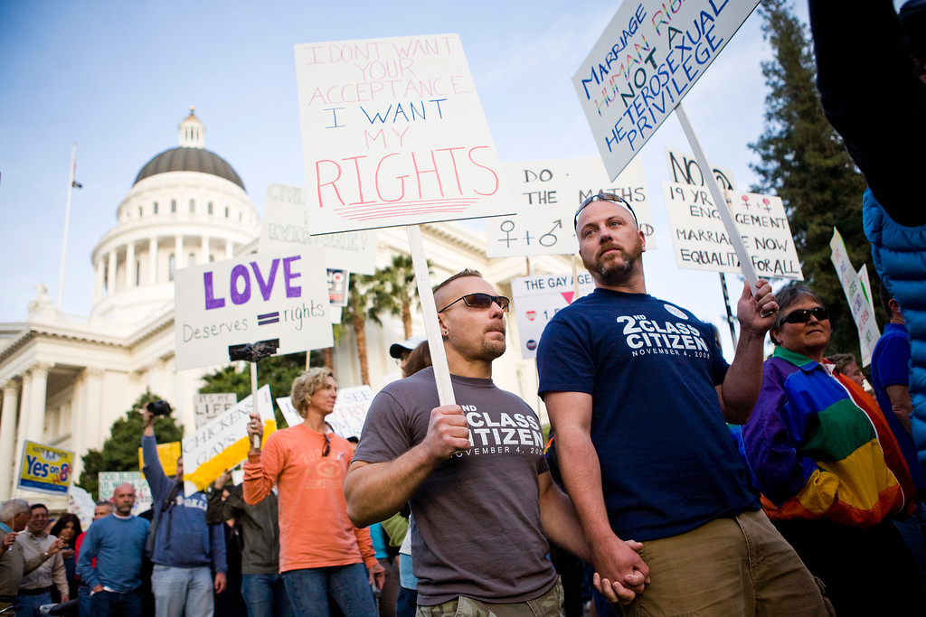 . SACRAMENTO, CA - NOVEMBER 22:  Ken Brendel (C) and Dana Edgar (R) march in support of gay marriage on the steps of the State Capitol November 22, 2008 in Sacramento, California. People across the country continue to protest the passing of California State Proposition 8 which makes gay marriage in California illegal. (Photo by Max Whittaker/Getty Images)