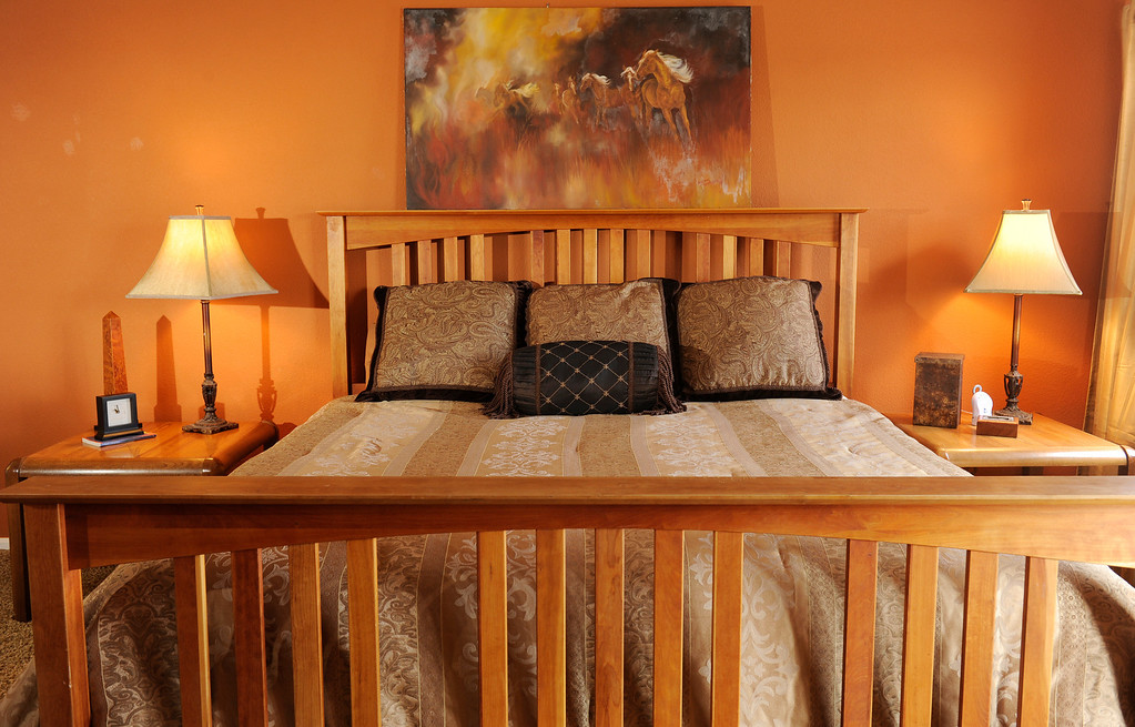 . In the master bedroom, Lewis\' own kingsize bed got new mattresses, a quilt and three European pillows from the ARC Thrift at Bowles Marketplace. (Photo By Cyrus McCrimmon/The Denver Post)
