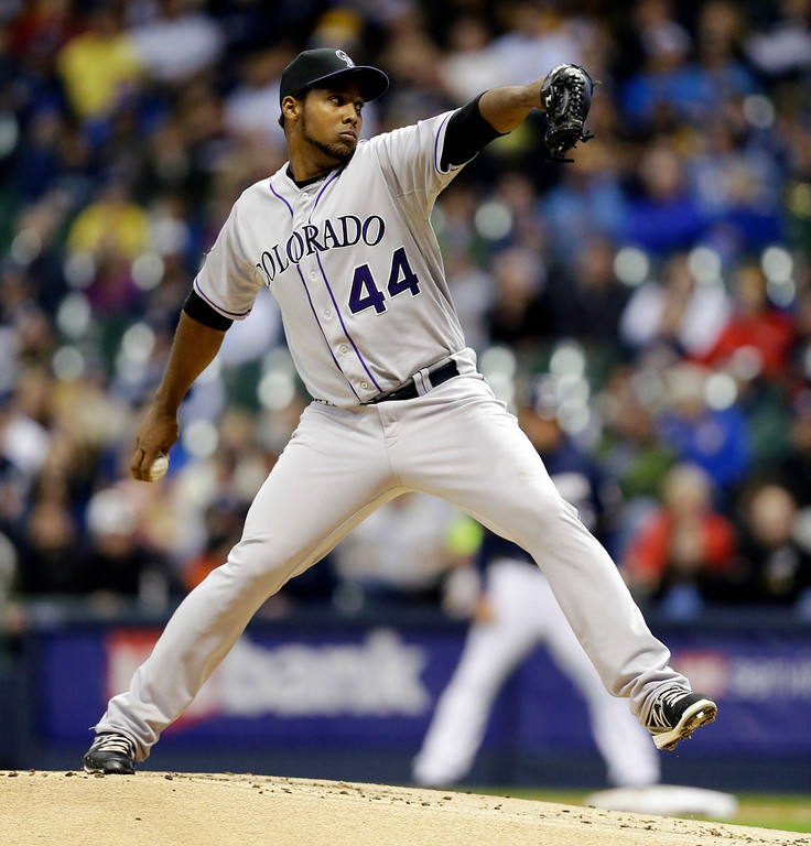 . Colorado Rockies starting pitcher Juan Nicasio throws to the Milwaukee Brewers during the first inning of a baseball game, Wednesday, April 3, 2013, in Milwaukee. (AP Photo/Jeffrey Phelps)