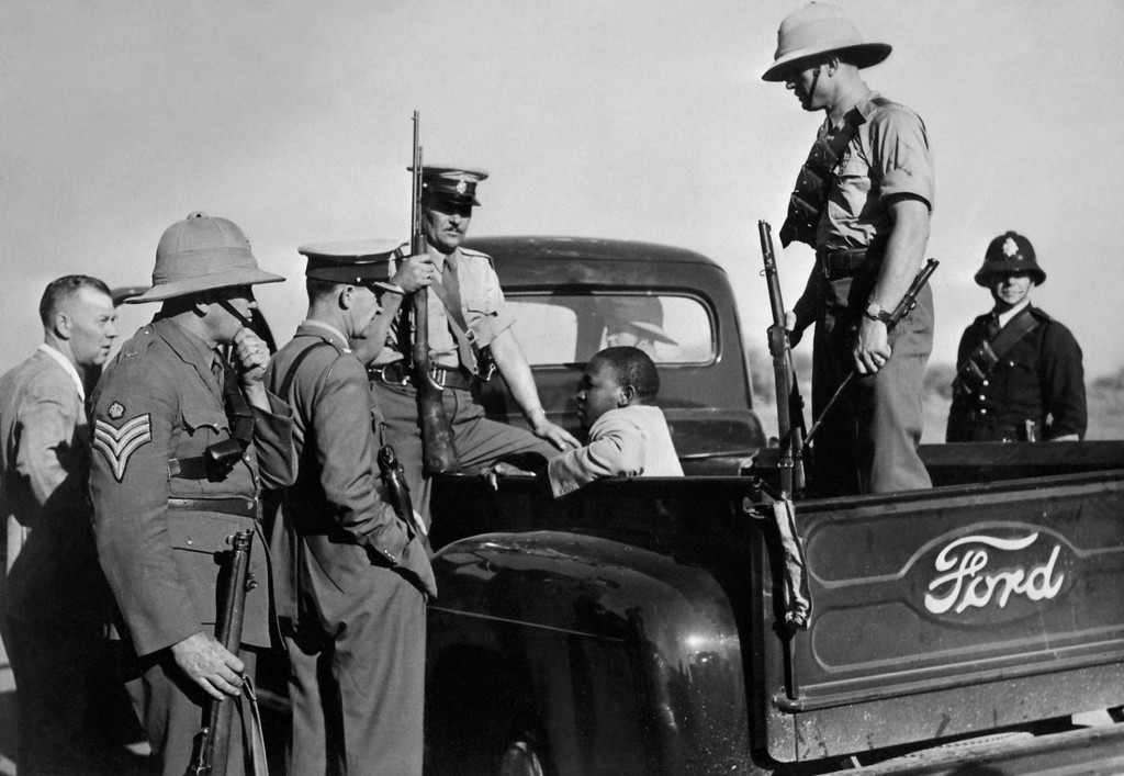 . A suspect is arrested and kept in a Ford police car as violence increased in East London, in November 1952. (AFP/Getty Images)