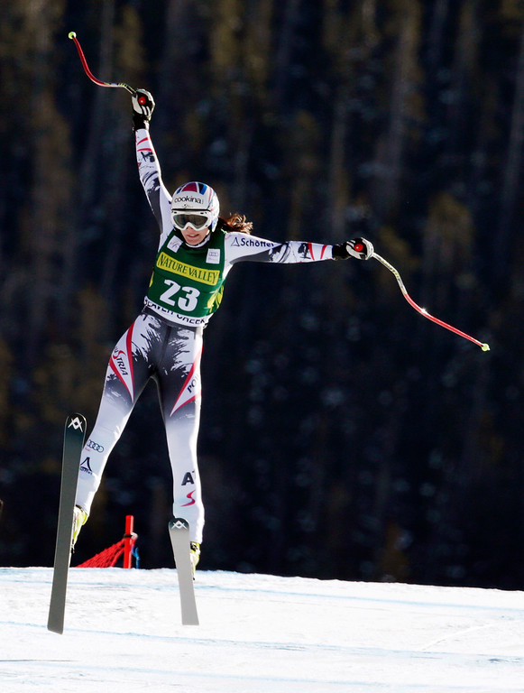 . Austria\'s Cornelia Huetter lands the last jump during the women\'s World Cup Downhill skiing event Friday, Nov. 29, 2013, in Beaver Creek, Colo. (AP Photo/Charles Krupa)