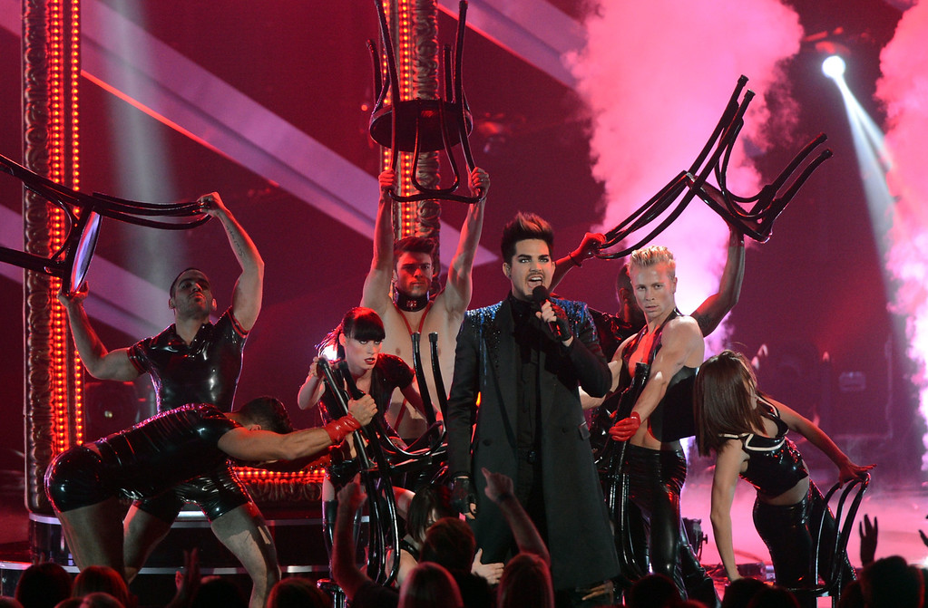 """. LOS ANGELES, CA - DECEMBER 16:  Host Adam Lambert performs onstage during \""""VH1 Divas\"""" 2012 at The Shrine Auditorium on December 16, 2012 in Los Angeles, California.  (Photo by Kevin Winter/Getty Images)"""