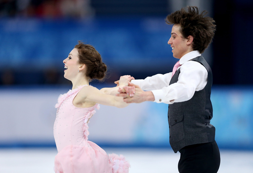 . Alexandra Paul and Mitchell Islam of Canada compete during the Figure Skating Ice Dance Short Dance on day 9 of the Sochi 2014 Winter Olympics at Iceberg Skating Palace on February 16, 2014 in Sochi, Russia.  (Photo by Matthew Stockman/Getty Images)
