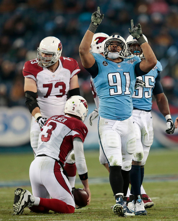 Description of . Tennessee Titans defensive tackle Jurrell Casey (99) celebrates after sacking Arizona Cardinals quarterback Carson Palmer (3) for a 9-yard loss in the second quarter of an NFL football game Sunday, Dec. 15, 2013, in Nashville, Tenn. (AP Photo/Wade Payne)