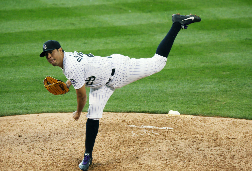 . Colorado Rockies starting pitcher Jorge De La Rosa works against the Washington Nationals in the eighth inning of the Rockies\' 6-4 victory in a baseball game in Denver on Wednesday, July 23, 2014. (AP Photo)
