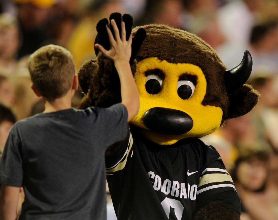. BOULDER, CO. - SEPTEMBER 76: CU mascot Chip gave a high-five to a young fan. The University of Colorado football team hosted Central Arkansas at Folsom Field Saturday night, September 7, 2013. Photo By Karl Gehring/The Denver Post