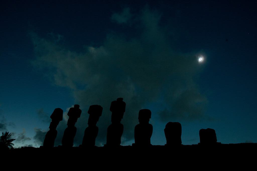 . Stone statues known as Moais are pictured during the total solar eclipse in Easter Island, Chile, some 4,000 km (2,480 miles) west of the Chilean coast, Sunday, July 11, 2010. (AP Photo/Patricio Munoz)
