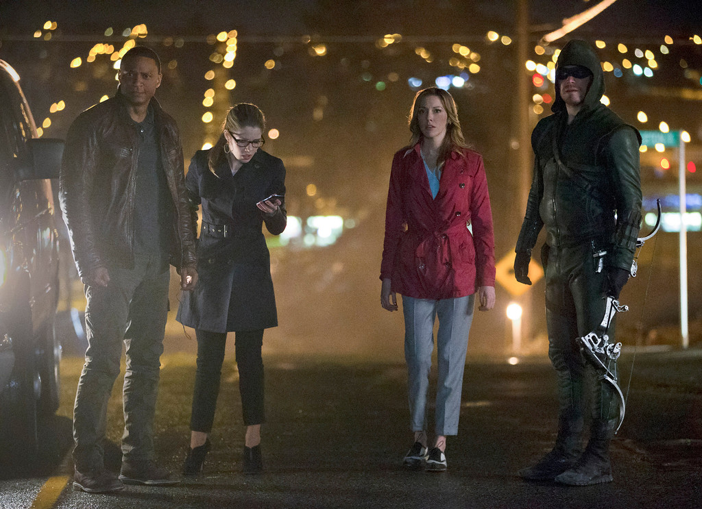 ". David Ramsey as John Diggle, Emily Bett Rickards as Felicity Smoak, Katie Cassidy as Laurel Lance, and Stephen Amell as The Arrow in The CW\'s ""Arrow.\""  (Photo by Jack Rowand/The CW -- © 2014 The CW Network, LLC. All Rights Reserved.)"