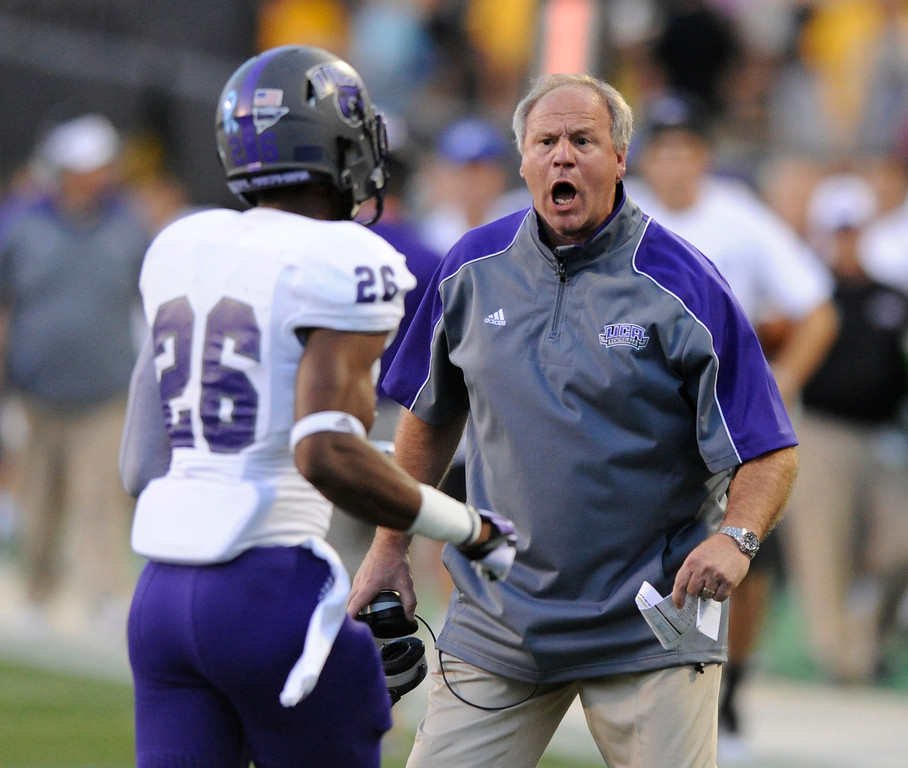 . BOULDER, CO. - SEPTEMBER 76: Bears coach Clint Conque shared his thoughts with defensive back Darius Reed (26) after he got burned for a touchdown in the first quarter. The University of Colorado football team hosted Central Arkansas at Folsom Field Saturday night, September 7, 2013. Photo By Karl Gehring/The Denver Post